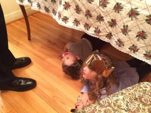 Penelope and her brother Graeme, playing under the table, on December 26th