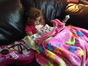 My granddaughter Penelope, losing her fight to stay awake.