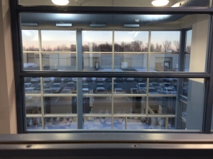 A room with a view of the parking lot