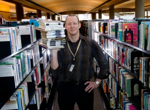 "Kim Raff | The Salt Lake Tribune Josh Hanagarne, an employee of the Salt Lake City Public Library system, struggled with Tourette Syndrome as a child and teenager before finding refuge in reading and strength training. Hanagarne, author of ""The World's Strongest Librarian"" is photographed at the City Library in Salt Lake City on April 29, 2013."