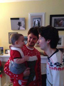 Graeme in his papa's arms, with Simon